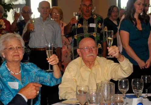 Linda and David Pain share a toast at his 90th birthday party in 2012.