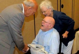 Linda and David Pain are greeted by World Masters Athletics President Stan Perkins in 2011 in Sacramento.