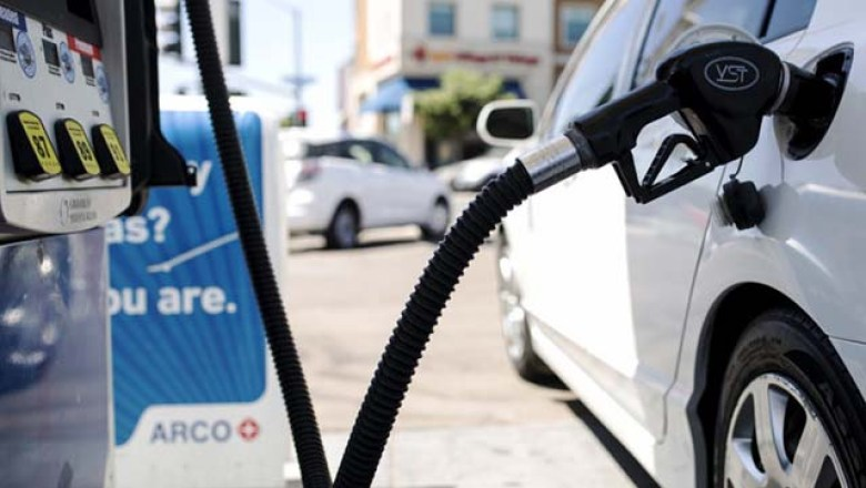 A car is fueled at a gas station near the San Diego State University campus.
