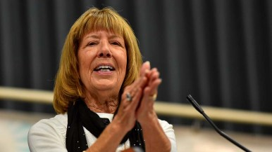 Secretary Linda Armacost applauded Chris Pearson, the club's vice president for political action, especially for electing Democrats to La Mesa offices.