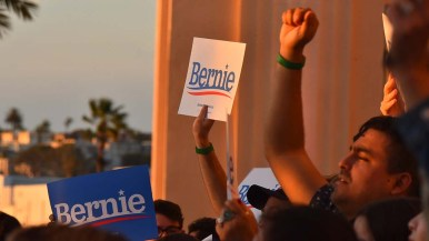 Sen. Bernie Sanders' supporters respond to his remarks in downtown San Diego.