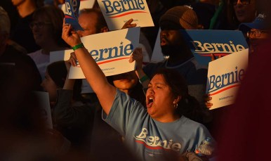 A Bernie Sanders supporter cheers his comments about increasing minimum wage.