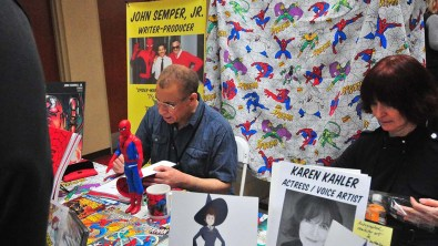 Artist John Semper, Jr., a former producer/story editor of Spider-Man: The Animated Series, signs autographs for visitors.