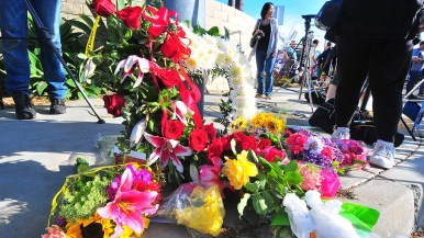 Flowers were left at the corner of Summerfield Lane and Espola Road across from the Chabad of Poway.