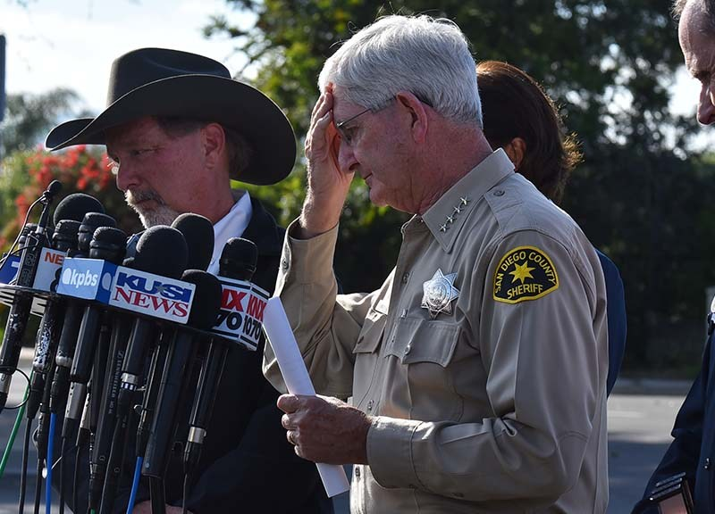 San Diego County Sheriff Bill Gore pauses during a press conference outside Chabad of Poway.