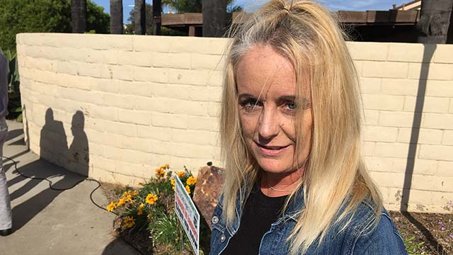 Ann Buerster of Rancho Bernardo, who brought a wreath to an intersection across the street from Poway synagogue, told of seeing the suspect.