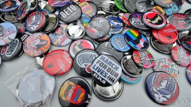 An assortment of campaign buttons was available for sale at a booth that also sold $20 Beto ballcaps and shirts.