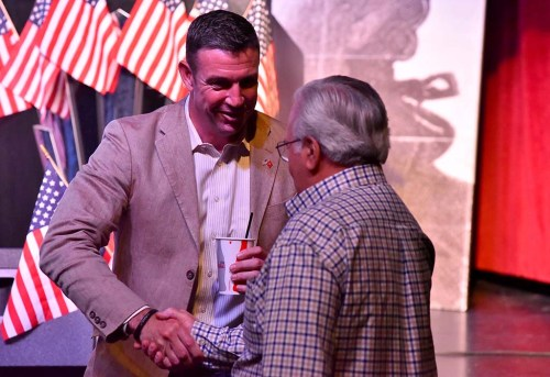 With a Coke cup in hand, Rep. Duncan D. Hunter shakes hands with audience member after his Ramona Mainstage remarks.