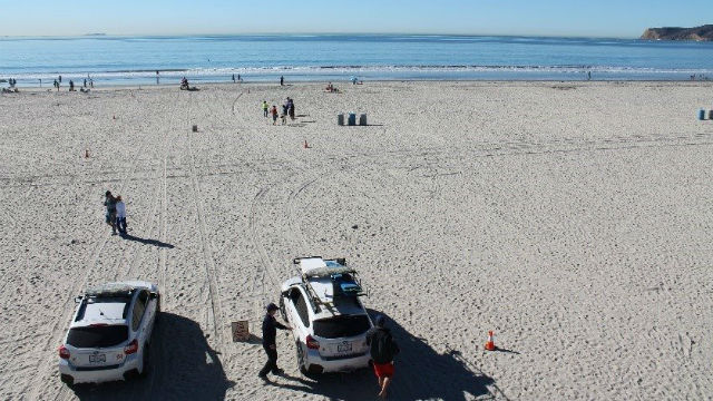 Coronado Lifeguard trucks on the beach
