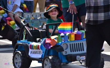 A young driver makes his way along the parade route.
