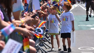 Children with Jewish Family Services greet parade goers along the route of the San Diego Pride Parade 2019.