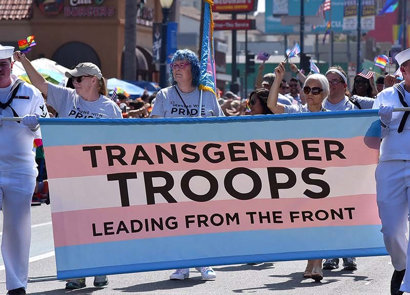 Military members march in support of transgender troops.