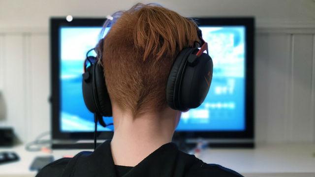 Teenager playing computer game
