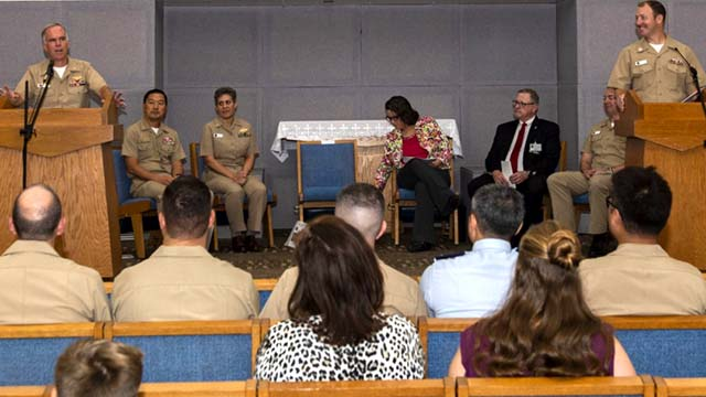 Capt. Bradford Smith (left), commanding officer of Naval Medical Center San Diego, and Lt. Benjamin Box, NMCSD clinical chaplain, speak at the clinical pastoral education residency program 2019 graduation ceremony at center's chapel.