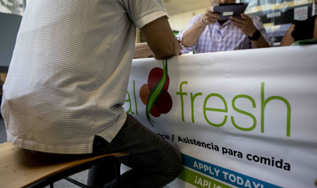 An applicant signs up for food stamps, known as CalFresh in California