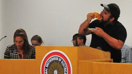 Party Chair Will Rodriguez-Kennedy fuels up on pizza early in Central Committee meeting.