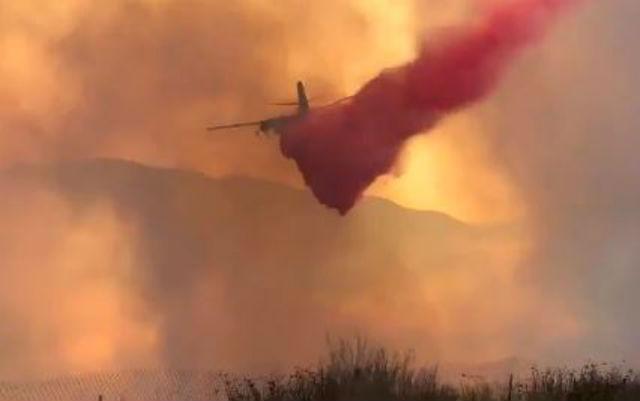 Plane drops fire retardant