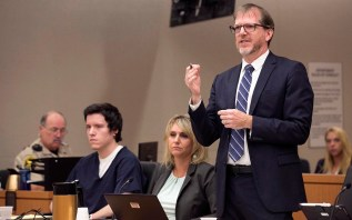 John O'Connell, attorney for John Ernest (left) questions witness Oscar Stewart during the preliminary hearing.