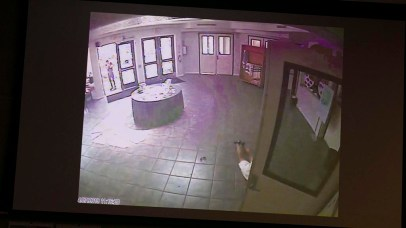 Surveillance video shows legs of Lori Kaye and the defendant standing at the doorway of the synagogue.