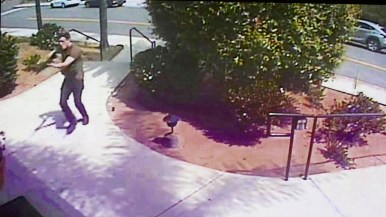 A frame grab of surveillance video shows the defendant entering the synagogue.
