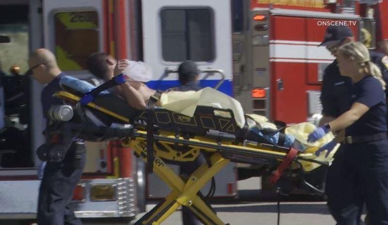 Suspect taken to an ambulance