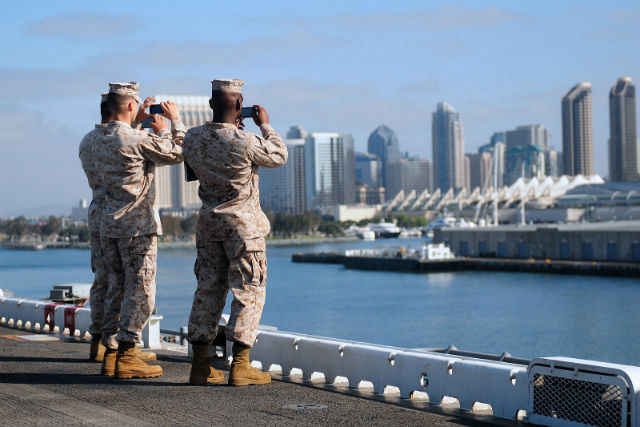 Marines aboard the USS Essex snap photos of the San Diego skyline