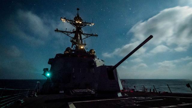 USS Dewey at night