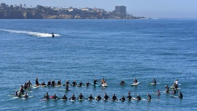 Rider on a personal watercraft joined about 35 people at ceremony south of Scripps Pier in honor of ocean scientist Walter Munk. Photo by Chris Stone