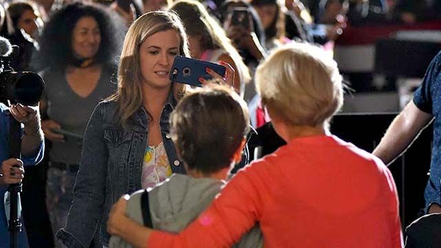 Nora Kate Keefe takes a picture of her boss, Sen. Elizabeth Warren, and a visitor to San Diego rally.