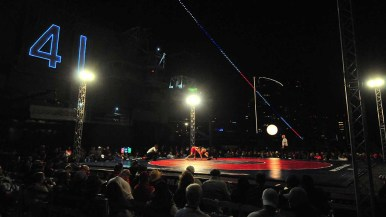 """The USS Midway """"41"""" overlooks flight-deck wrestling event, which kicked off the national collegiate season."""