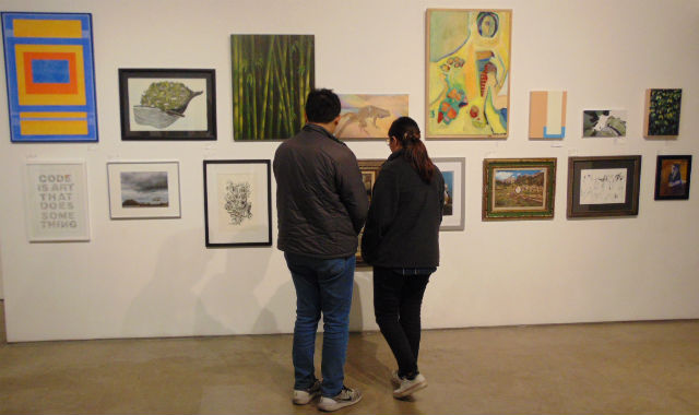 Couple examining art