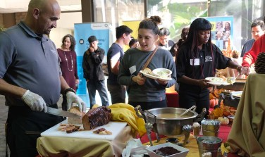 About 25 students enjoyed a traditional Thanksgiving dinner at the Educational Cultural Complex, thanks to Rep. Scott Peters.