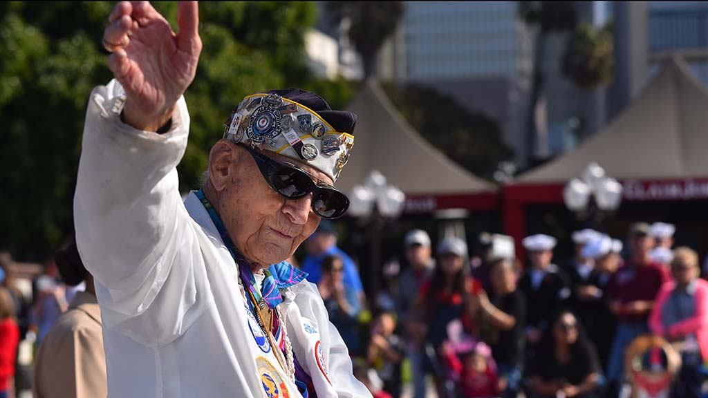 Pearl Harbor survivor Stuart Hedley waves to spectators at the 2019 Veterans Day Parade.