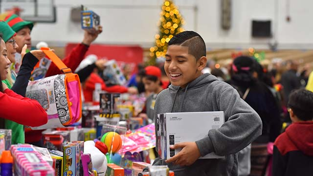 Anthony Lopez, 12, is happy to receive a radio control car for the holidays.