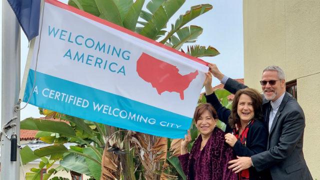 Chula Vista Mayor Mary Casillas Salas with the welcoming flag