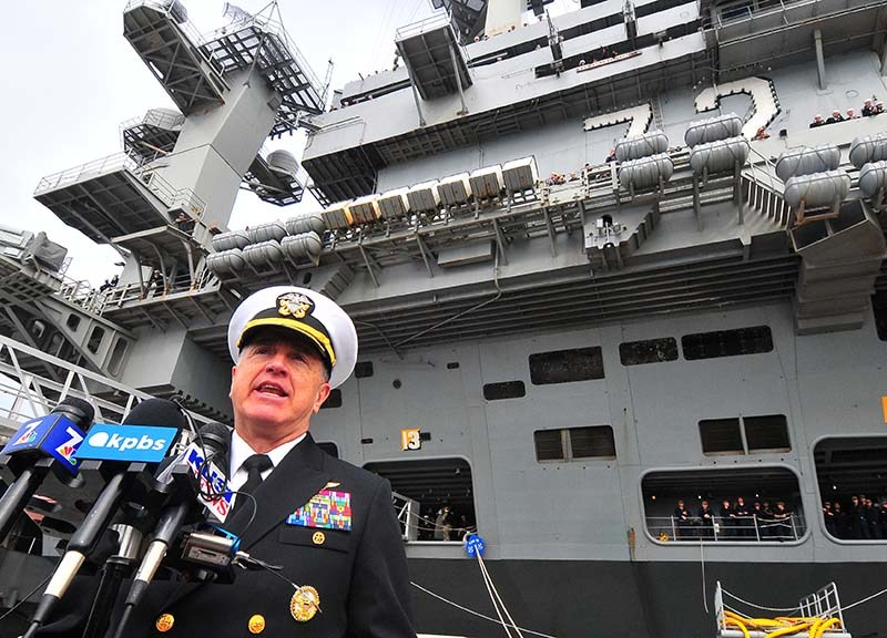 Rear Rear Adm. Michael E. Boyle addresses the press after arrival of the carrier USS Abraham Lincoln.