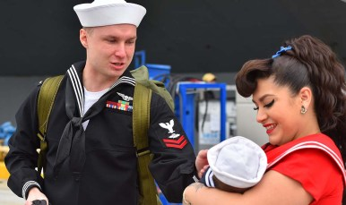 USS Abraham Lincoln sailor Michael Sikorski meets his 6-week old son, Ryder held by his mother Alexis.