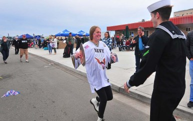 Thousands of family members greeted sailors as they arrived in San Diego on t