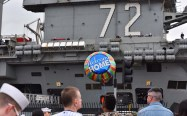 Families and friends welcomed the service members of the USS Abraham Lincoln with balloons and flowers.