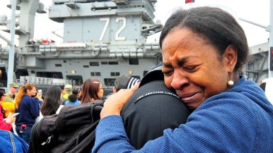 Sheila Joseph holds tight to her son, Charles, after he came off of the USS Abraham Lincoln at a homecoming on Coronado.