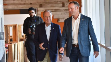Sumner Lee (right), founder of Fuse, shows presidential candidate Mike Bloomberg his Linda Vista business.