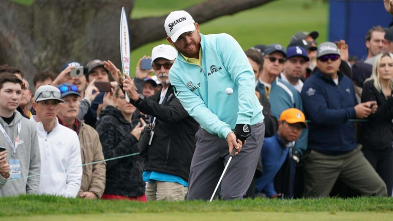 B.J. Holmes makes a chip shot in the fourth round of the Farmers Insurance Open.