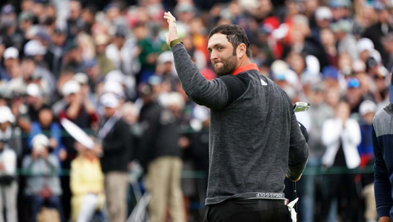 Jon Rahm waves to the crowd after finishing play at the Farmers Insurance Open on Sunday.