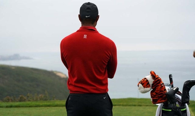 Tiger Woods waits for golfers to finish on the 3rd green of the south course of the Farmers Insurance Open in the fourth round