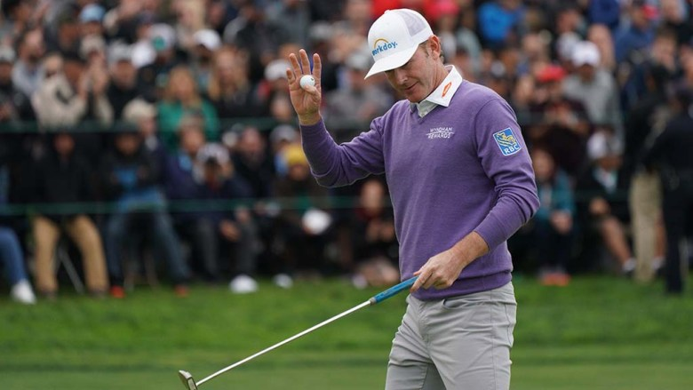 Brandt Snedeker acknowledges the crowd as he finishes the 18th green of the south course at Farmers Insurance Open.