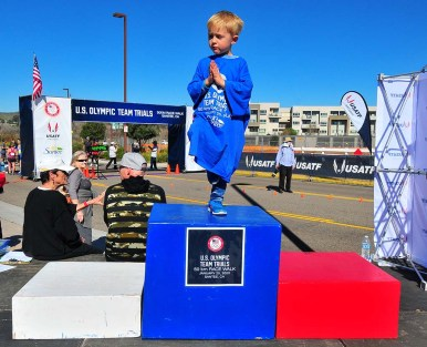 One of Andreas Gustafsson's sons warms up winner podium minutes before Olympic Trials awards ceremony.