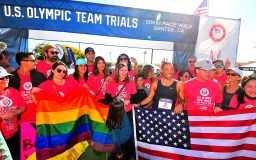 Matt Forgues poses with friends, Old Glory and a gay-pride flag after runner-up finish in Olympic Trials 50K walk.