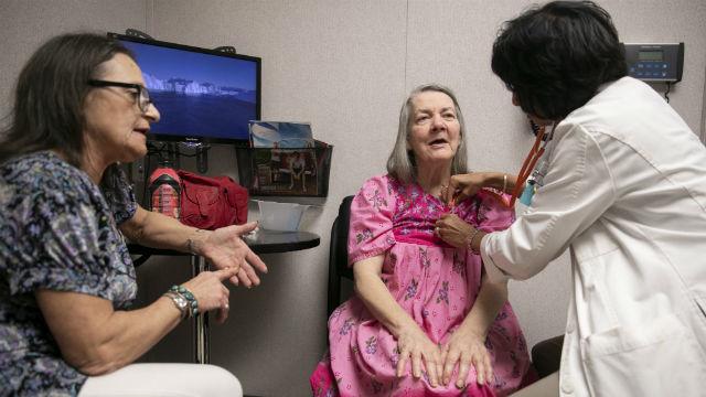 A nurse practitioner treats a patient