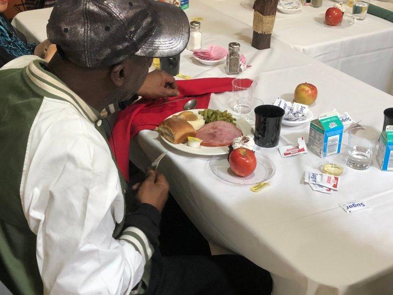 A senior having a meal