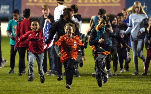 Children have the run of the field before San Diego Legion's inaugural game at Torero Stadium.